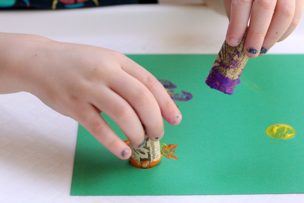 "Cork Stamped Flower craft is a fun for spring, a flower theme, a ""F is for flower"" letter of the week activity, and a perfect craft for Mother's Day!"