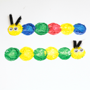 Preschool Caterpillar Craft -make these cute, fun, cork painted caterpillars. There are so many learning activities you can do with them!